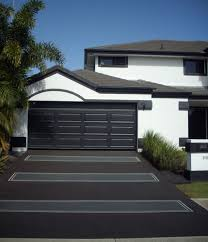 concrete driveway black and grey matching white house with black