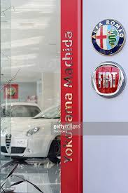 owns fiat inside fiat spa s alfa romeo dealership photos and images getty