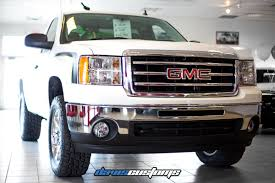 lifted white gmc davis customs truck customization lift kits wheels bumpers