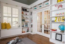 Bookcase In Wall Traditional Playroom With Hardwood Floors U0026 Window Seat In