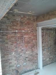 the exposed bricks will be protected by external wall insulation