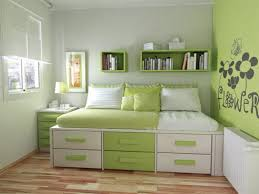 bedroom green wall paint color white wooden bed frame wooden