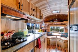 foxy airstream interior design with wooden furnishing and modern