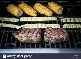 Focus Grill Rib Eye Steak With Zucchini And Corn On Gas Grill Soft Focus