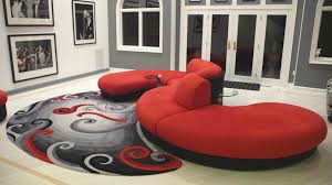 living room red curved sofa feat small twin glass coffee table