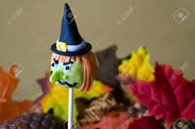 cake pop halloween colorful green and orange halloween witch cake pop on a stick