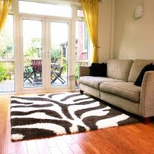 decorating with rugs on carpet rug along white cabinet white fur
