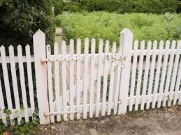an old white picket fence and garden gate stock photo picture