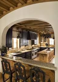Kitchen Cabinets Grey Color by Fancy Tudor Style Kitchen With Brown Color Wooden Kitchen Cabinets