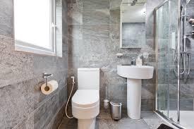grey tiled ensuite loft conversion bathroom constructed by simply
