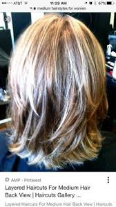 best haircut for over 50 woman with jowls and hooded eyelids