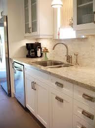 Brushed Nickel Backsplash by White Shaker Style Cabinets With Modern Brushed Nickel Hardware