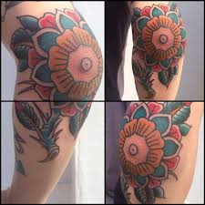 colorful traditional flower tattoo on elbow