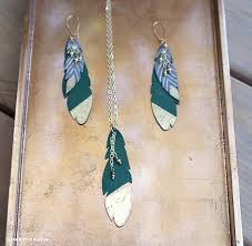 make feather earrings diy leather feather earrings lia griffith