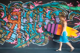 graffiti art bringing edgy personality to hotels a surfer walking past the hotel erwin in venice beach ca