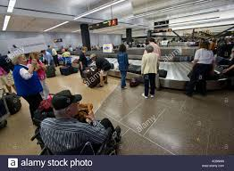Washington travelers images Travelers collecting luggage at the baggage carousel sea seattle jpg