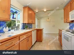 blue maple cabinets kitchen kitchen interior maple cabinets blue tile stock photo edit