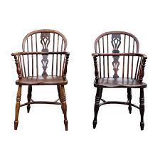 pair of antique english oak windsor chairs on the highboy