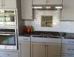 porcelain tile kitchen backsplash gorgeous made tile is the focal point of this white kitchen