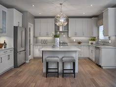 grey and white kitchen by urban grace interiors via instagram