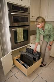 roll out drawers for kitchen cabinets slide out shelves kitchen slide out shelves make cooking easier wood