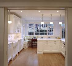 wood pendant lighting kitchen traditional with white counters