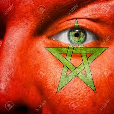 Flag Face Flag Painted On Face With Green Eye To Show Morocco Support Stock