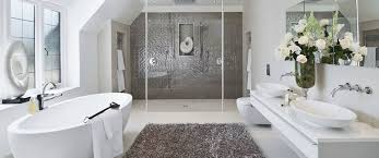 luxury bathrooms color scheme and placement of fixtures makes room appear larger