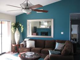 Living Room In Spanish by Living Room Stunning Blue Wall Paint In With Tripod Floor Lamp And