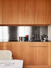 cleaning wood kitchen cabinets neat and clean stainless steel back splash accents sleek cabinet