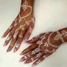 white henna tattoo with baby pink and gold glitter nail art by