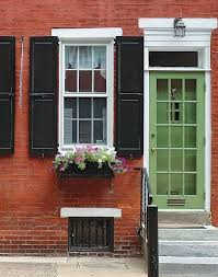 love this brick black shutters with white accents u0026 green door