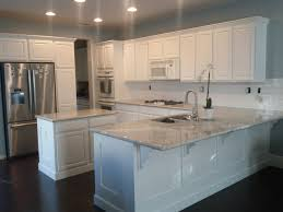 river white granite countertops home decor waplag kitchen cabinets river white granite countertops home decor waplag kitchen cabinets with kashmir and dark wooden flooring also recessed lights in