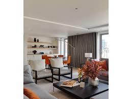 modern icons bookshelves eames lounge chair colorful chevron area