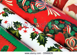christmas gift wrap rolls colourful green and white christmas decorations on a