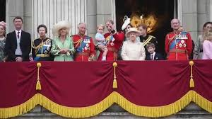 the royal family are seen waving from buckingham palace after
