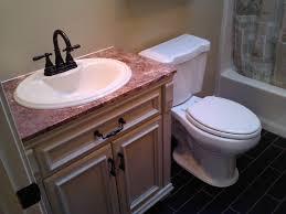 bathroom brown bathroom vanity white sink stainless faucet white