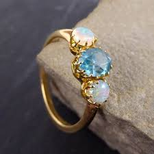 blue zircon rings images Edwardian opal and blue zircon ring modeled in 18ct gold jpg