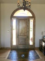 sherwin williams accessible beige with wood front door and slate