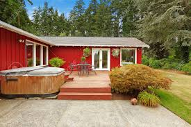 Beautiful Decks And Patios by Beautiful Bright Red House With Patio Area And Walkout Deck Stock