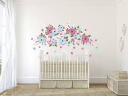 bubble gum graphic flower clusters floral wall decals urban walls an assortment of bubblegum coloured flower decals on a white wall behind a white crib