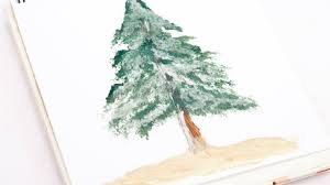 paint a realistic pine tree with snow diy guidecentral