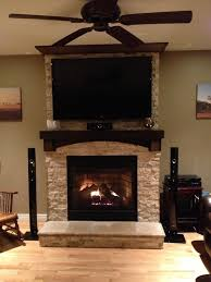 stone on fireplace with tv mounted over mantle i like the mantel
