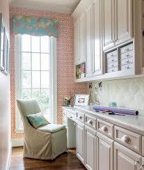 Long Craft Room With Built In Desk And Pink Board Backsplash - Backsplash board