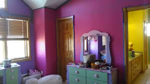 purple green and pink hardwood floors and black front doors