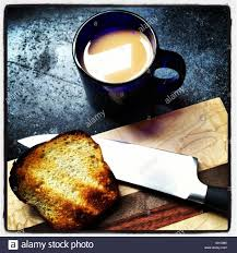 top of coffee cup a simple shot of coffee and toast on a soapstone counter with