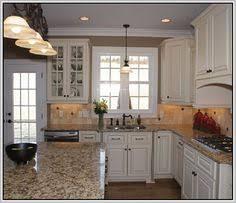 Santa Cecilia Backsplash Ideas by White Cabinets With Granite Countertops Santa Cecelia Granite