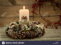 elegant centerpiece for the christmas table with a candle on a