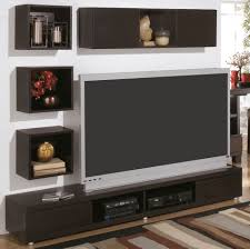 modern wall mount tv stand and floating shelf decor idea on living
