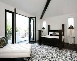 lush black and white bedroom with folding door and four posters